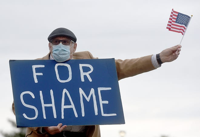 Paul Steeno of Columbia was one of about 30 protesters who gathered Tuesday evening along the sidewalk in front of the Country Club of Missouri to protest Sen. Josh Hawley, who was attending a fundraiser there. Four Hawley supporters also attended the protest.