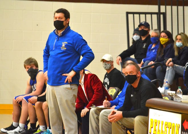 Alanson head boys basketball coach Brian Kujawa (left) looks on during a recent Division 4 district final against Pellston in Pellston. Kujawa, a former Cheboygan basketball great, is now leading the way for the Vikings. Meanwhile, Barry Salter (right), Kujawa's former head coach at Cheboygan and current Cheboygan varsity girls head coach, has been helping Kujawa as a voluntary assistant coach since late last season. Last week, the two got to celebrate together as the Vikings secured the district title with a hard-fought victory over the Hornets.