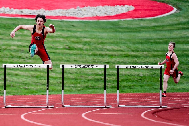 Already winner of the meet's 110-meters high hurdles race, Chillicothe High School junior Braxten Johnson clears the last hurdle on the curve during the 300-meters intermediate hurdles race during the March 30 Brookfield Open meet held in Chillicothe. Johnson took this race by over two seconds with his 48.34 seconds clocking.