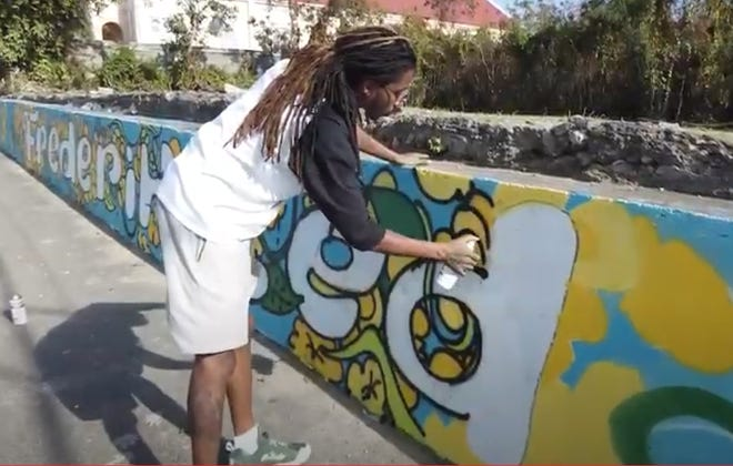 Hakim Callwood working on a mural in the U.S. Virgin Islands