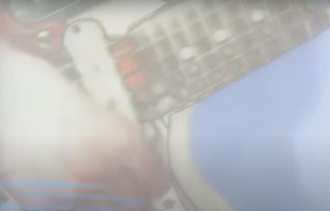 """From My Bloody Valentine's restored """"Swallow"""" video. A blurry guitar might as well be a MBV band photo."""