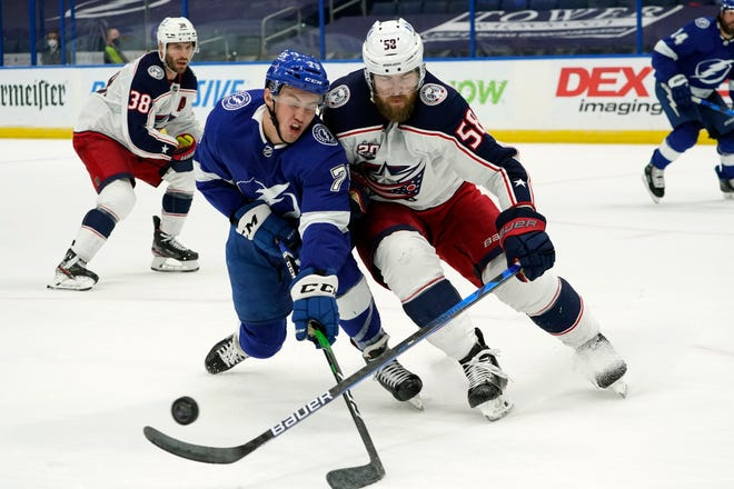 Blue Jackets defenseman David Savard, right, leans into Tampa Bay forward Ross Colton during the Jackets' 3-1 win on Tuesday. Columbus plans to employ a less complicated, more defensive approach for the stretch run of the season.