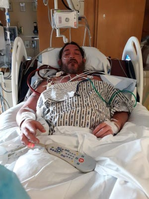 Greg Borden, 40, of Enon, rests in a bed at Ohio State University's Wexner Medical Center after receiving a double-lung transplant. Borden needed the transplant after suffering a severe case of COVID-19.