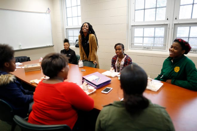 Jac'quese Hargrove, standing, director of teen programs and services for the Boys & Girls Club of Columbus, meets with a group of girls, clockwise from left, Antionette Jones, Asia Anderson, Saurelle Tsala, Alysiah Webster, Rayne Alexander and Alana Green, as part of a mentoring program at Hamilton Township High School on Nov. 28, 2018. The program is coordinated by Communities in Schools of Central Ohio, a nonprofit that helps students overcome obstacles to academic achievement.[Adam Cairns/Dispatch]