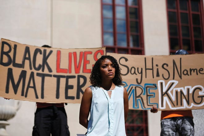 In this September 2016 file photo, Amber Evans, lead organizer for the People's Justice Project, waits to speak during a rally in response to the fatal police shooting of 13-year-old Tyre King.