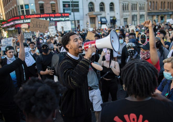 Ohio State basketball player Seth Towns gives an impassioned speech to protesters during a demonstration in Downtown Columbus on May 31, 2020.