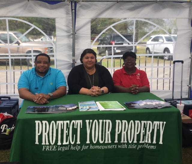 From left, Gerren Sias and Susie Price and Salyria Gumms-Williams of Southeast Louisiana Legal Services help out at an outreach fair.