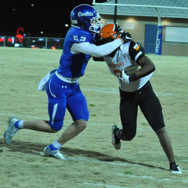 Asheboro's Logan Richardson tackles a Southeast Guilford receiver. The Blue Comets play rival Southwestern Randolph on Thursday. [Mike Duprez/Courier-Tribune]