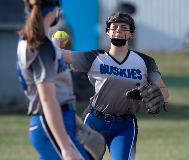 Emma Ewing throws out a runner from the hot corner.