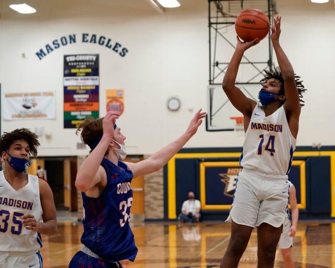 Madison's Rovahn Roberts shoots a jump shot during Tuesday's Division 3 regional semifinal against Lenawee Christian at Erie Mason.