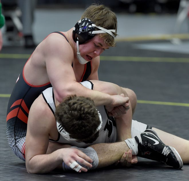 Logan Badge of Clinton works towards pinning Kody Krupp of New Lothrop at 189 pounds winning the match with a major decision 16-5 in the D4 Team State Championship at the Wings Event Center in Kalamazoo.