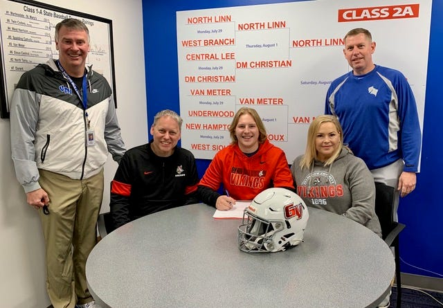 Pictured, from left, are Van Meter Athletic Director Rick Roberts, John Gilliland, Max Gilliland, Holly Gilliland and Van Meter High School head football coach Eric Trudo.