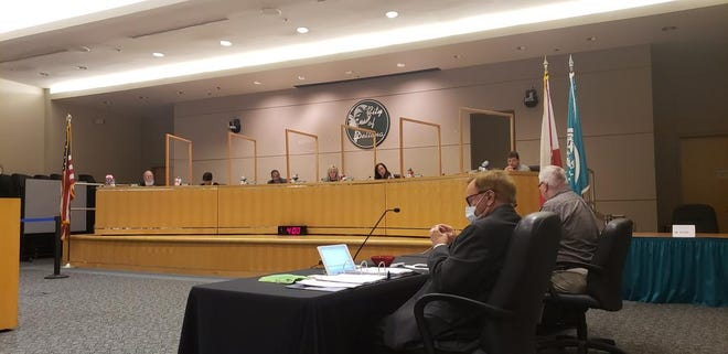 Plexiglass barriers were installed on the dais in Deltona so that city commissioners could return to their usual seats with some additional COVID-19 mitigation.