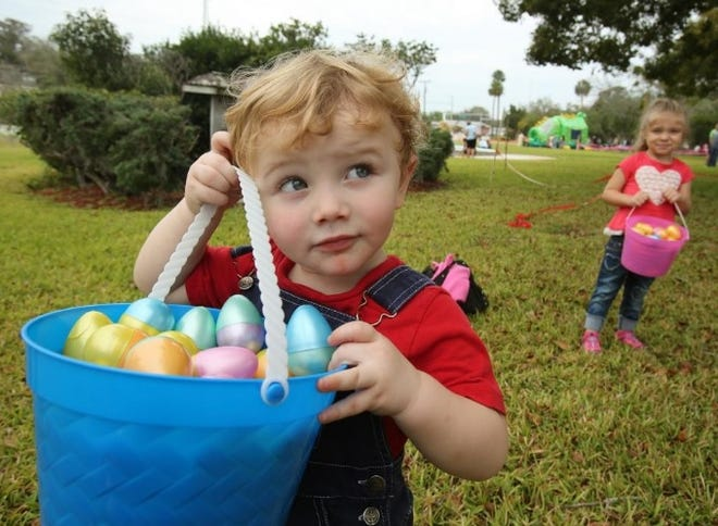 Austin Haney shows off his collection of plastic eggs during an Easter egg hunt in Holly Hill in 2016.