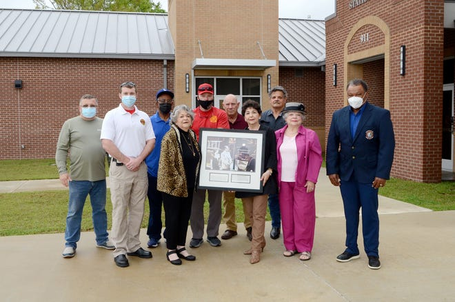 """The family of the late Ralph Falsetta joined the Donaldsonville Fire Department and Ascension Parish Library to hang photos at the new fire station and the library March 25. Shown from left are: former Fire Chief Chuck Montero, Fire Chief Adam Gautreaux, Councilman Lauthaught Delaney, Rosalyn Griffin, Councilman Michael Sullivan, Ronald Diez, Marilyn """"Meme"""" Diez, former Constable Andrew """"Banana"""" LeBlanc, Judy LeBlanc Falsetta, and Mayor Leroy Sullivan."""