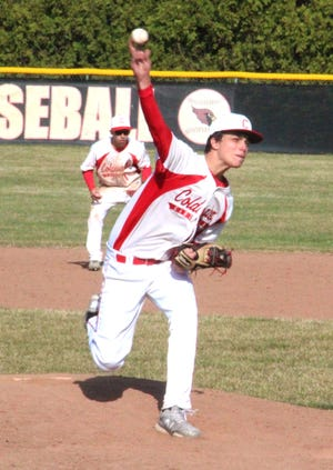 Coldwater's Carter Bordner delivers from the mound Tuesday in the Cardinals season opening win versus Three Rivers