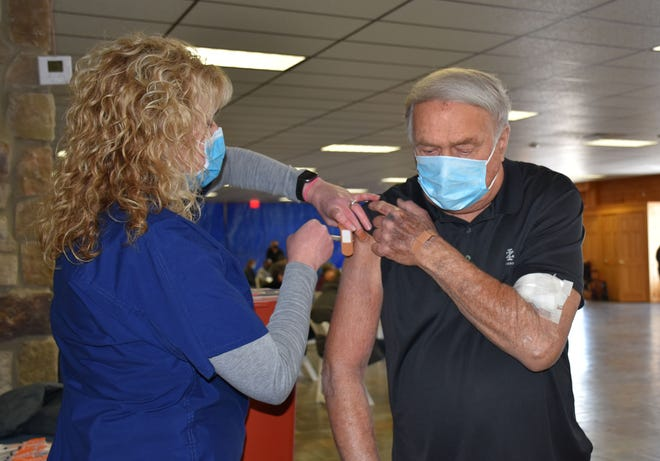 Thomas Bajadek, Honesdale, receives a COVID-19 vaccine from Sarah Mickel, LPN at a Wayne Memorial Community Health Center clinic at the former Rusty Palmer site in Honesdale on March 19th. More clinics are planned for this same site and elsewhere in April. Visit COVID Vaccine Registration - Wayne Memorial Hospital (wmh.org) for information.