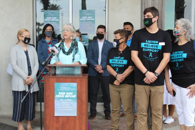 Atlantic Beach Mayor Ellen Glasser speaks Tuesday during a Beaches Sexual Assault Awareness Campaign kickoff event Tuesday outside Surfer the Bar in Jacksonville Beach. The $10,000 City of Jacksonville-funded advertising campaign seeks to educate the community on ways to prevent sexual assault before it happens and to empower victims to seek support. Also joining Glasser were UNF student Emily  Echevarria (from left) Jacksonville Beach Mayor Chris Hoffman, Neptune Beach Mayor Elaine Brown and Councilman Rory Diamond, among others.