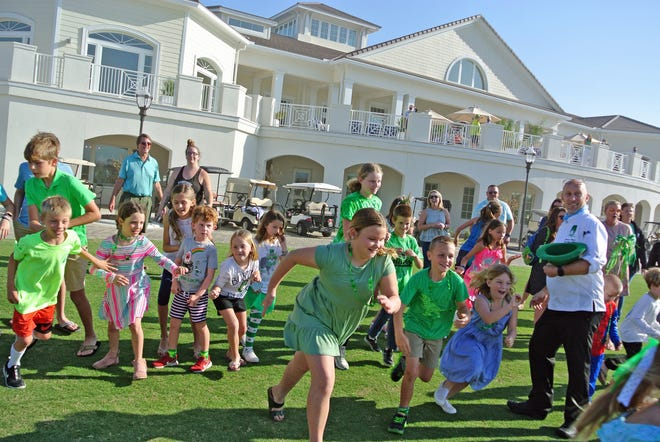 On St. Patrick's Day,  Sawgrass Country Club held a Catch the Leprechaun contest organized by executive chef Michael Meuse (right).  When the kids spotted the leprechaun they were off and running.