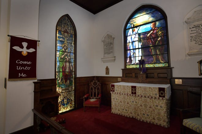 The Tiffany stained glass window (right) in the original section of Trinity Parish stands out from the many other vintage stained glass windows in the St. Augustine church that is celebrating its bicentennial this year.