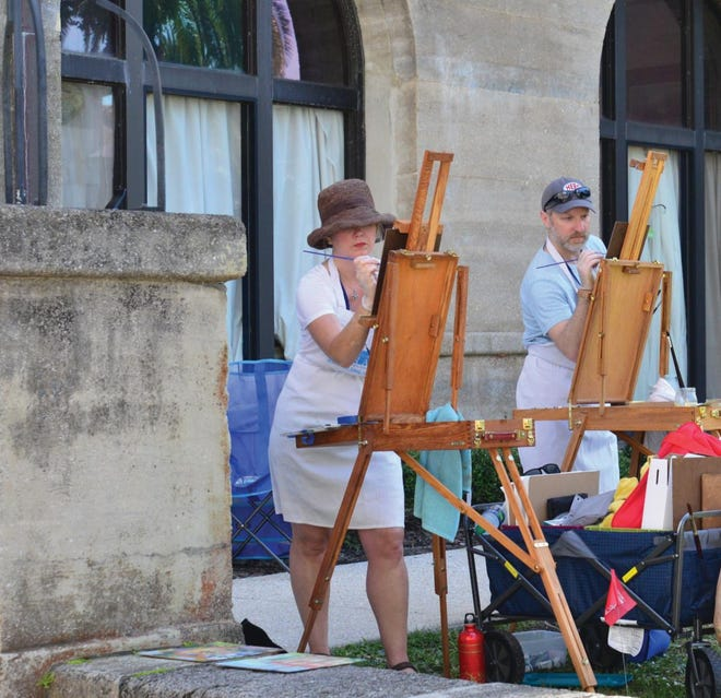 Artists are shown at the Lightner Museum during the Quick Draw portion of the 2019 Plein Air Paint Out.