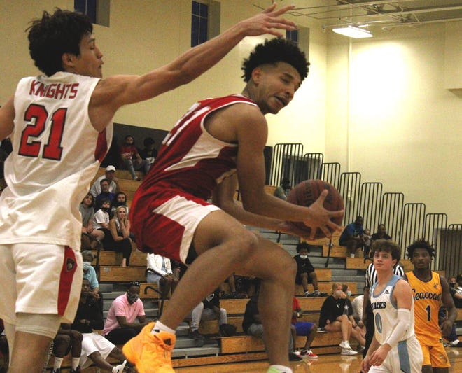 Bishop Snyder guard Justin Hicks pulls down a rebound against Creekside's Ethan Miller during the Jacksonville Senior All-Star Game for boys basketball on March 26, 2021. [Clayton Freeman/Florida Times-Union]
