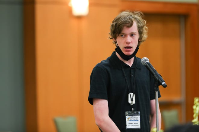 James Dover, an eighth-grader at Belmont Middle, spells a word during the 2021 Gaston Gazette Spelling Bee at Gastonia Conference Center on Wednesday, March 31.