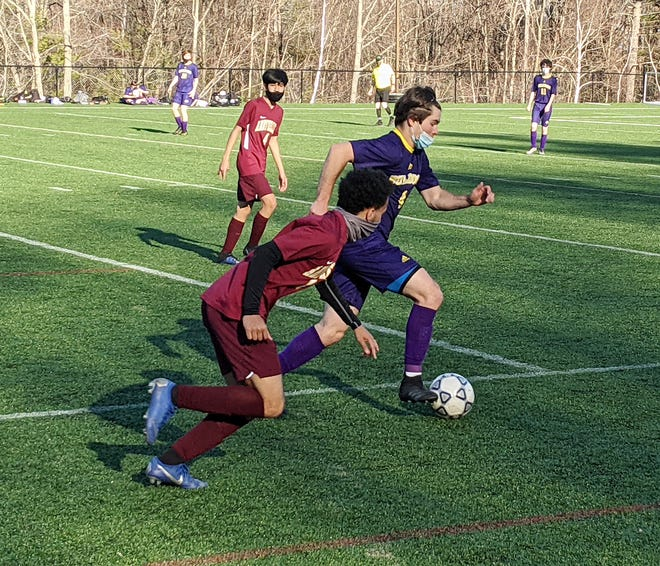 Monty Tech's Donovan Hynes advances the ball against Abby Kelley's Izaiah Njuguna during Tuesday afternoon's game at Game On Sports & Performance Center in Fitchburg.