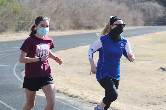 Narragansett junior Kylie Marion, left, runs with new Warriors girls' track coach Dayna Margarita-Dixon during a recent team practice at Kenneth Bockus Athletic Field in Baldwinville.