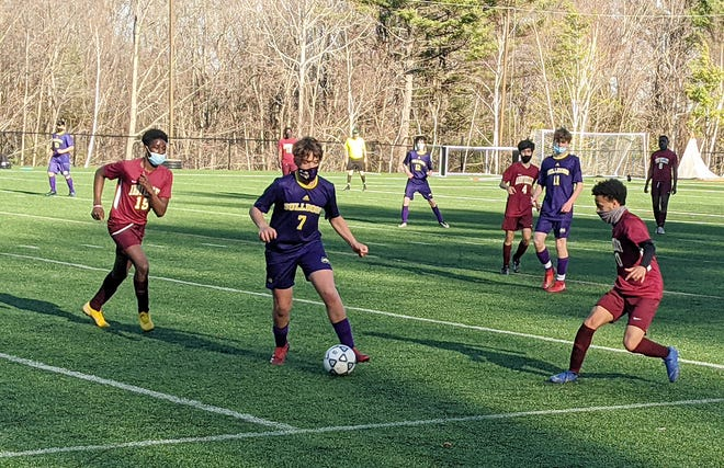 Monty Tech's Cameron Gadarowski (7) possesses the ball in between Abby Kelley's Jenkyn Attafah (19) and Izaiah Njuguna during Tuesday's game at Game On Sports & Performance Center in Fitchburg.