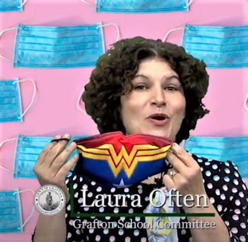 "School Committee Chair Laura Often shows one of her favorite face masks — Wonder Woman — as part of the town's ""Show Us Your Mask"" campaign, which urges people to wear face masks."