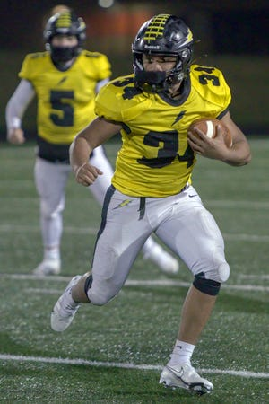 Galesburg junior running back Damian Thomas looks upfield for running room during the Silver Streaks' 46-17 win over Quincy on Friday, March 26, 2021 at Van Dyke Field.