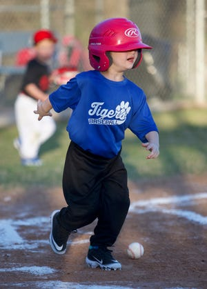 Taytum Shuemake, 4, runs to first base after putting the ball in play on Friday night, opening night of the tee-ball season in Glen Rose.