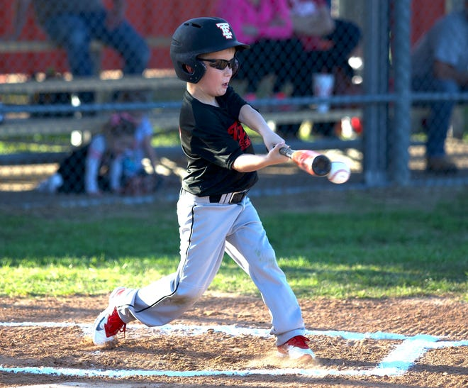 Easton Ross squares up a pitch on Friday on opening day of the youth baseball season.
