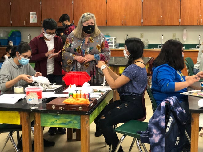 Piner Middle School students work to create alebrijes, Mexican papier-mache folk art, Tuesday afternoon.  Piner Art Teacher Martha Stephens was awarded a $450 grant for the project from Ruiz Foods.