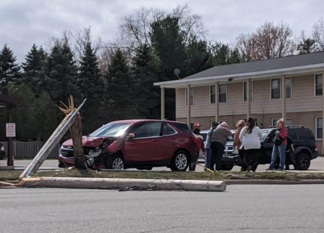 An 81-year-old Holland man suffered minor injuries following a two-vehicle crash which resulted in a broken utility pole Wednesday, March 31.