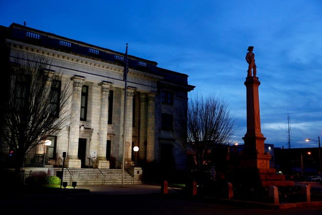 In this March 9, 2020 photo, a monument to Confederate soldiers is seen in front of the Alamance County Courthouse in Graham. On March 30, 2021, the North Carolina chapter of the NAACP filed a lawsuit seeking the removal of the Confederate monument in front of the county courthouse. (AP Photo/Jacquelyn Martin, File)