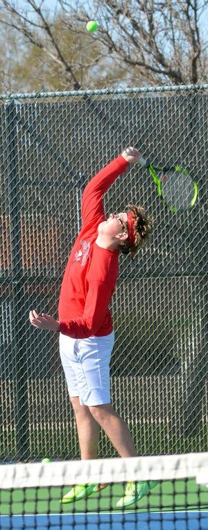 Hesston senior Cole Deutschendorf serves during the first doubles title Tuesday at the Hesston Invitational.