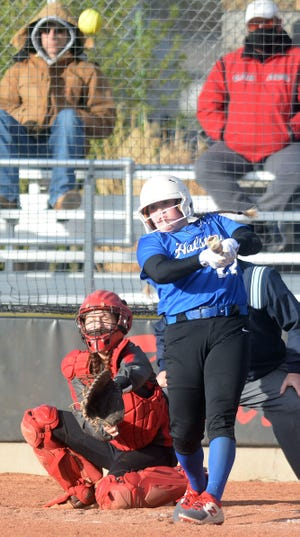 Halstead player Brittley Day hits a home run during play Tuesday against Hesston.
