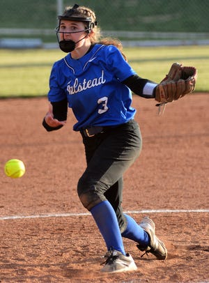 Halstead pitcher Emma Boese throws against Hesston during play Tuesday in Hesston. The Dragons swept the rival Swathers.