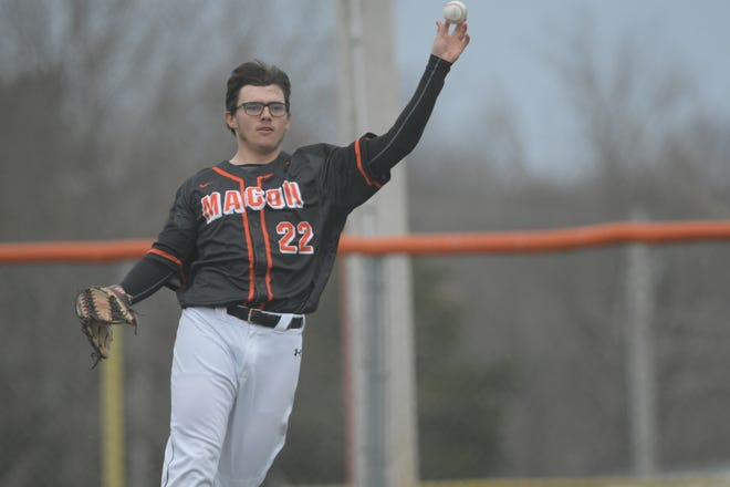 Macon's Jakeb Swallow throws the ball in from right field after making a catch Tuesday against Westran.