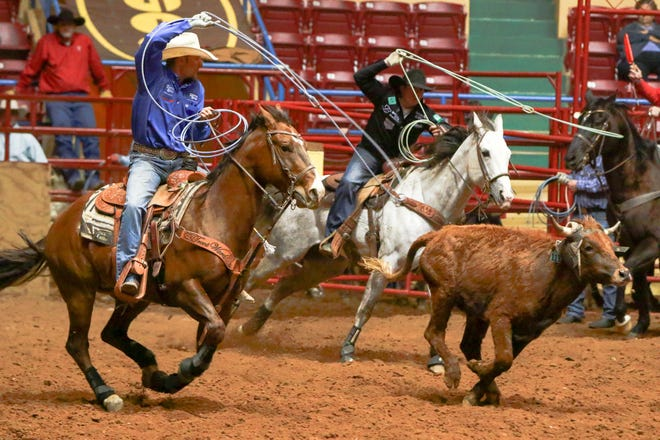 Billy Bob Brown and Logan Medlin compete in team roping during a 2017 performance of the ABC Pro Rodeo at Municipal Coliseum. The 78th ABC Pro Rodeo is back after a one-year hiatus with performances starting Thursday at the Mallet Event Center and Arena in Levelland. (John Moore/For A-J Media)