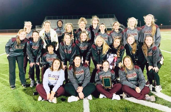 The Eldon girls track and field team celebrates their win at the Blair Oaks Invitational on March 26 in Wardsville.