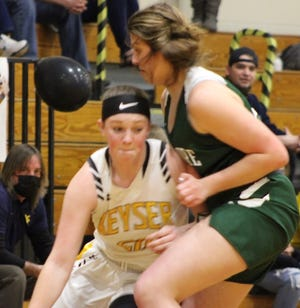 Keyser's Alexa Shoemaker drives hard to the basket. Shoemaker led Keyser with 13 points and hit a three pointer at the buzzer to win the game for the Lady Tornado.