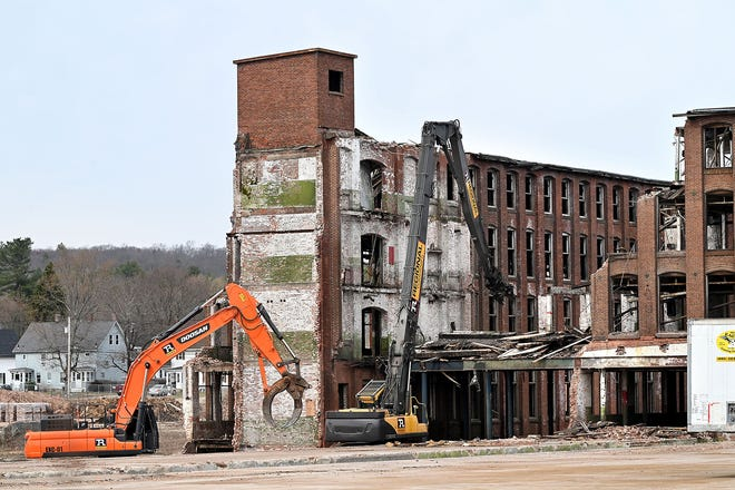 Excavators dig into the former Draper Mill factory in Hopedale, March 24, 2021.