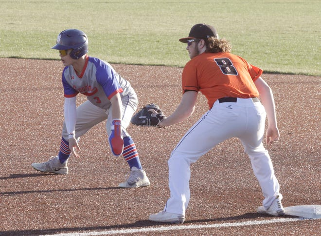 Moberly senior Ethan Vandall wears a sliding glove on his left hand as he takes a lead off first base. Vandall produced the Spartans only base hit Tuesday in a 7-0 home loss to Hannibal.