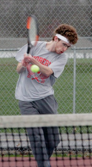 Moberly senior Nick Faiella returns a back hand stroke Tuesday during his No. 1 doubles match playing alongside William O'Loughlin. The Spartans duo fought off Boonville's Gabe Greis and Tucker Kaiser to win 9-7, helping Moberly to also win the dual meet by an 8-1 varsity result.