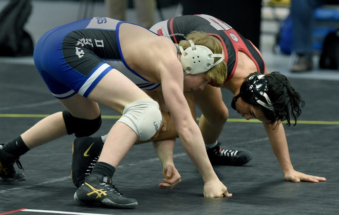Braeden Davis of Dundee takes down Ty Whalen of Whitehall at 112 pounds Tuesday in the Division 3 state finals at the Wings Event Center in Kalamazoo.