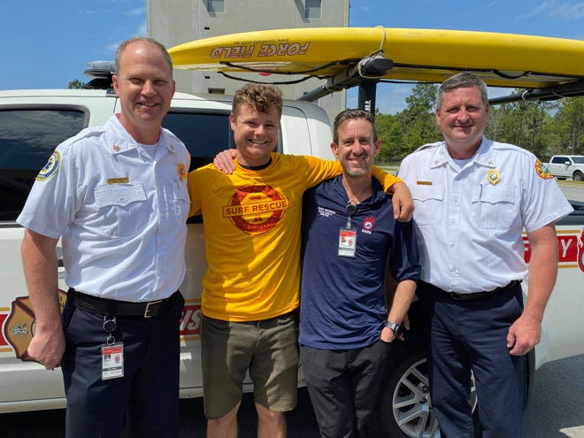 """South Walton Fire District Fire Chief Ryan Crawford, lifeguard Zander Angelovic, Beach Safety Director David Vaughan and EMS Chief Tim Orenic (left to right) pose for a photo after Angelovic rescued a struggling swimmer. Vaughan shared water safety tips on """"Good Morning America"""" recently."""