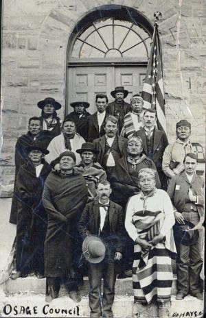 Olo-hah-walla, the ancestor of Oklahoma Historical Society researcher Veronica Redding, is fourth from left on the second row of this Osage Council photo taken in 1895.